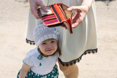 crying little girl and empty wallet - stock photo