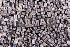 Close up of typeset letters with the word tarmac Stock Photos
