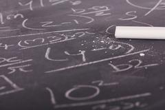 Close up of blackboard with maths equations - stock photo