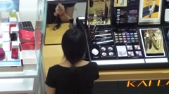 Women's cosmetics counters, women in the beauty - stock footage