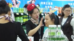 Chinese women do facial care and beauty Stock Footage