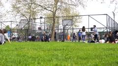 Children have fun on playground in park Stock Footage