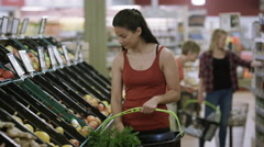 4K Mother & daughter shopping together at the grocery store Stock Footage