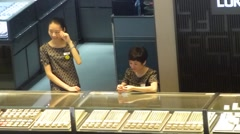 Female employees of the gold jewelry store Stock Footage