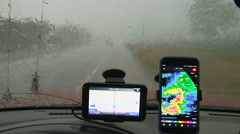 Storm chaser caught in severe thunder and rain storm - stock footage