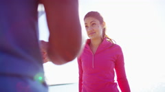 Multi Ethnic male and female in Lake Michigan sun flare resting after exercise Stock Footage