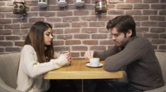 Young couple arguing in the cafe Stock Footage