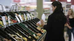 4K Cheerful mother & daughter shopping together at the grocery store Stock Footage