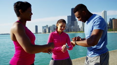 Multi Ethnic male and females Chicago city stretching and checking smart watch Stock Footage