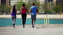 Multi Ethnic male and females in Chicago city outdoors running for wellbeing Stock Footage