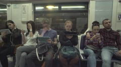 People Are Using Tablets While Riding A Metro Stock Footage