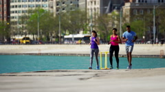 Multi Ethnic male and females in Chicago city outdoors running for fitness Stock Footage
