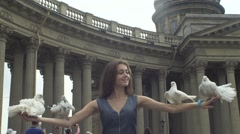 Girl Releasing A Pigeons From Her Arms - stock footage