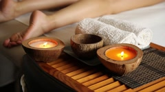 Young woman gets a foot massage in the spa salon. close-up of candles Stock Footage