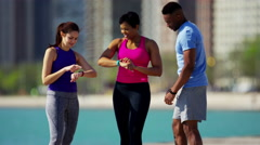 Multi Ethnic male and females in Chicago resting and stretching with smart watch Stock Footage