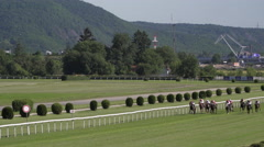 Horses galloping at a horse race in a racecourse in Prague Stock Footage