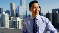 Portrait of Asian American business consultant on rooftop overlooking Chicago Stock Footage