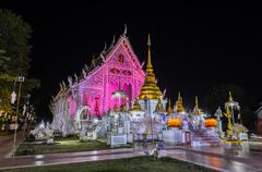 Beautiful night illuminated view of Thai temple Stock Photos