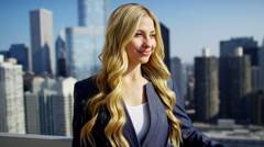 Portrait of Caucasian American female consultant on rooftop overlooking Chicago Stock Footage