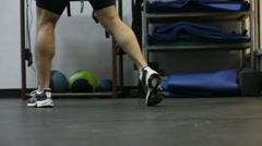 Close up of legs of of boxer wich performs exercises with a punching bag Stock Footage