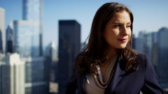 Portrait of Latin American female consultant on rooftop overlooking Chicago Stock Footage