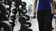 The stand with gymnastic dumbbell in the gym - stock footage