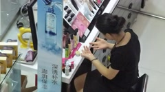 Women's cosmetics counters, women in the beauty Stock Footage