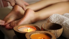 young woman gets a foot massage in the spa salon. close-up of candles. male - stock footage