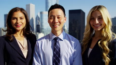 Portrait of ethnic business managers on rooftop overlooking cityscape Chicago Stock Footage