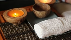 Massag in spa salon. candle burns, masseur puts the towels Stock Footage