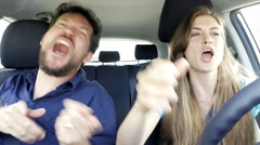 Happy people dancing like crazy in car driving 4K - stock footage