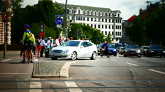 Biker ask direction Traffic light commuters zebracross Rush Hour busy road  - stock footage