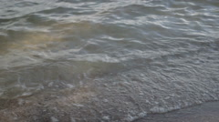 Small waves on the beach at the lake Stock Footage