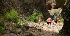 Hiking slot box canyon family recreation DCI 4K Stock Footage