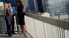 Multi ethnic business managers planning projects on city rooftop Stock Footage