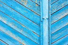 Aged wooden texture of planks and slats painted in a bright vibrant blue colo Stock Photos