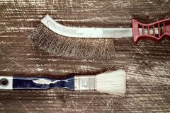 Wire brush and paintbrush Stock Photos