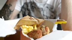 Man takes photo via Mobile Sell Phone of food Chicken and French fries Potato Stock Footage
