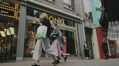 Carnaby Street shoppers passing the Monki fashion store, London, UK Stock Footage