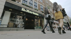 Carnaby Street shoppers passing the Dr Martens shoe store, London, UK - stock footage