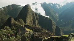 Machu picchu and wild orchids on a misty morning Stock Footage
