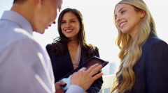 Handshake of multi ethnic male and female business team using tablet technology Stock Footage