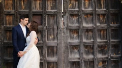 Bride on the background of the gates of the castle Stock Footage