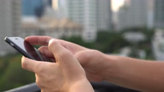 Man Browsing Social Net Using Mobile Phone at Evening Time at Roof in Big City Stock Footage