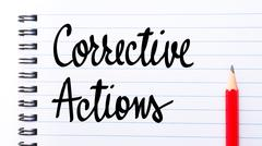 Corrective Actions written on notebook page Stock Photos