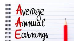 AAE Average Annual Earnings written on notebook page Stock Photos