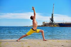 Caucasian man acts yoga Stock Photos