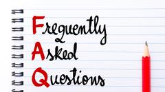 FAQ Frequently Asked Questions written on notebook page Stock Photos