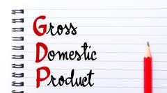 GDP Gross Domestic Product written on notebook page Stock Photos