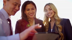 Handshake of multi ethnic business team using touchscreen technology on rooftop Stock Footage